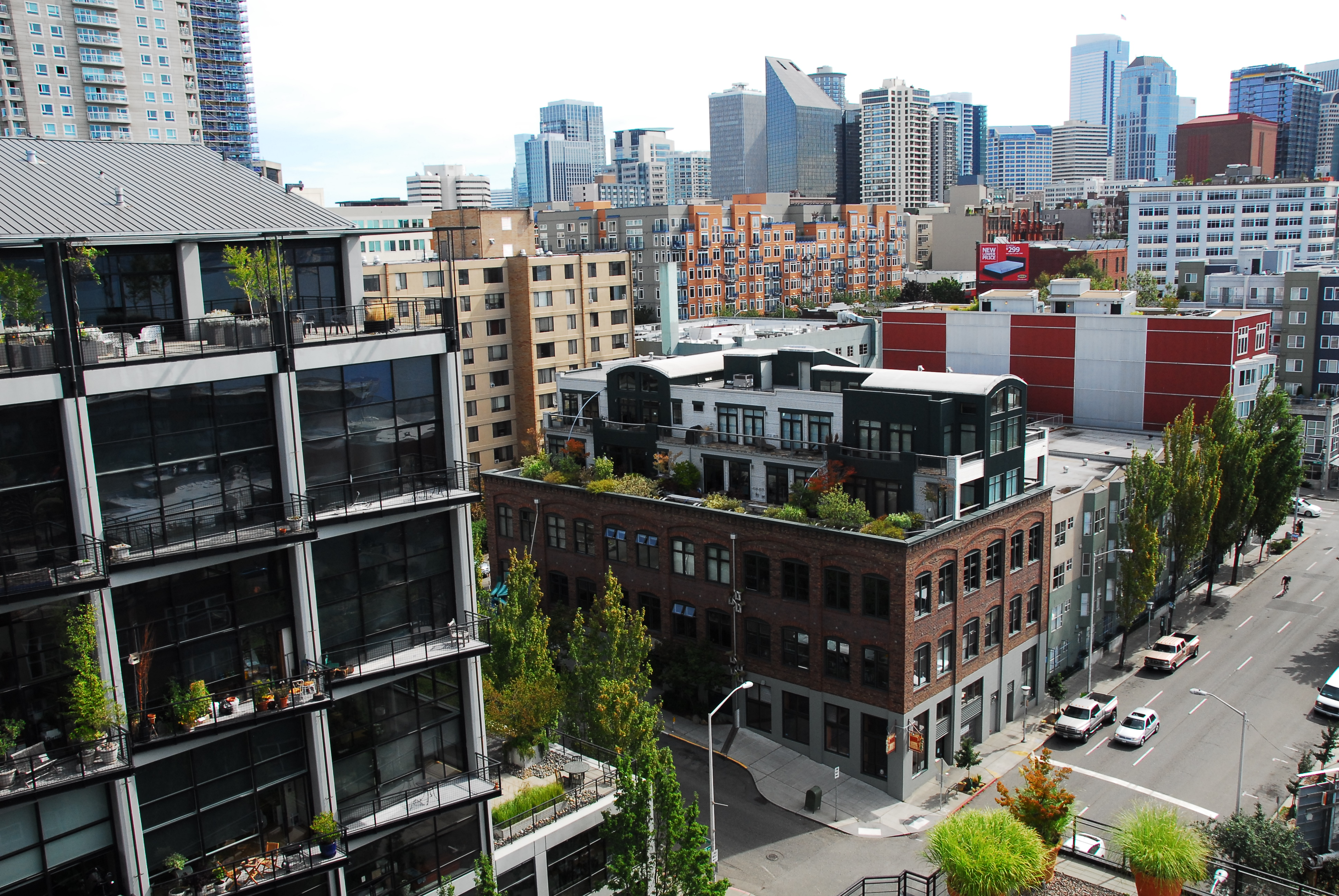 pcl construction restarts work on tower in belltown