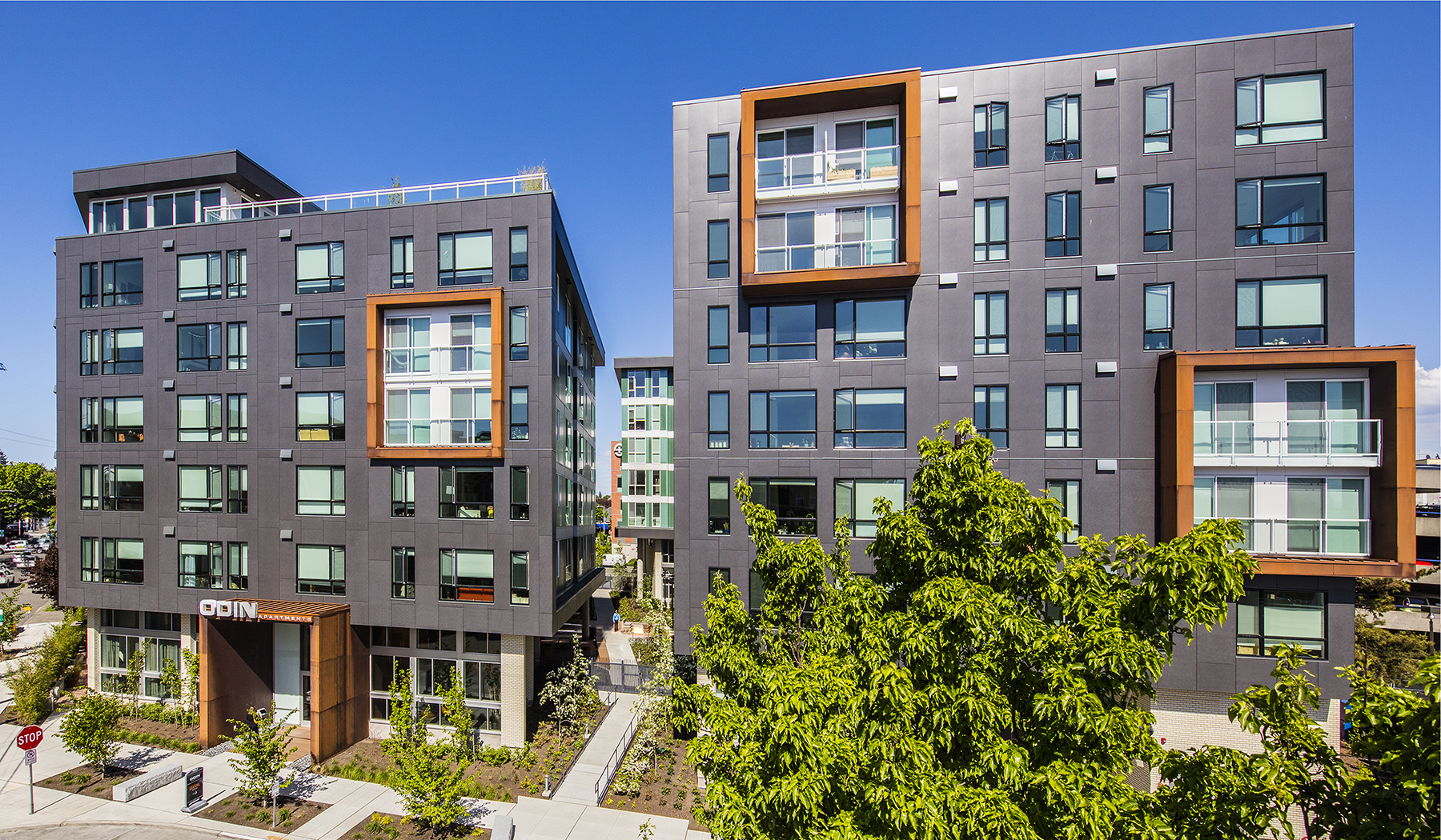 Runberg architecture group s odin apartments awarded naiop for Multi family living